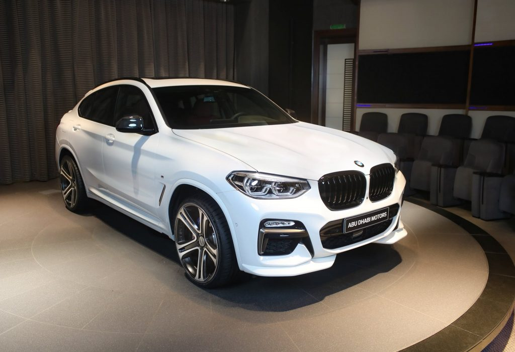 BMW X4 M40i in Alpine White with Tacora Red Interior